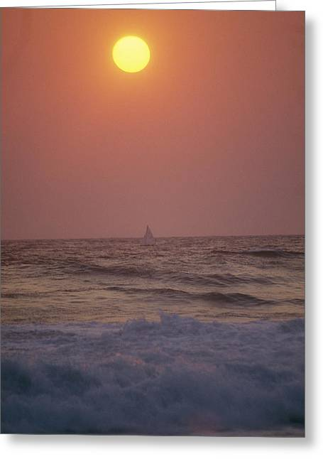 Surf Breaks On A Beach At Sunset. A Greeting Card by Raul Touzon