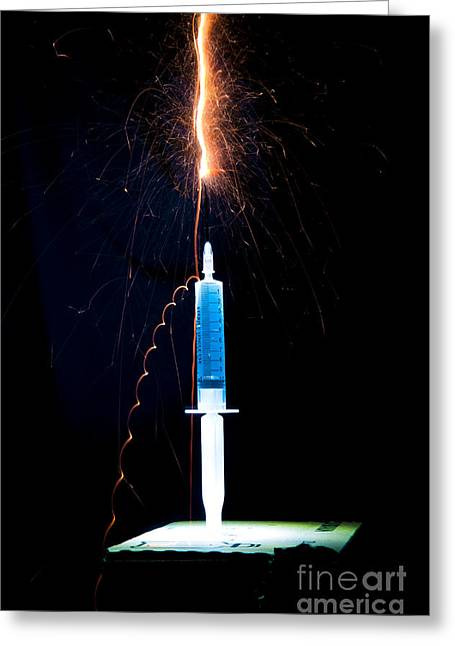 Injections Greeting Cards - Syringe Disperses Lighting Greeting Card by Guy Viner