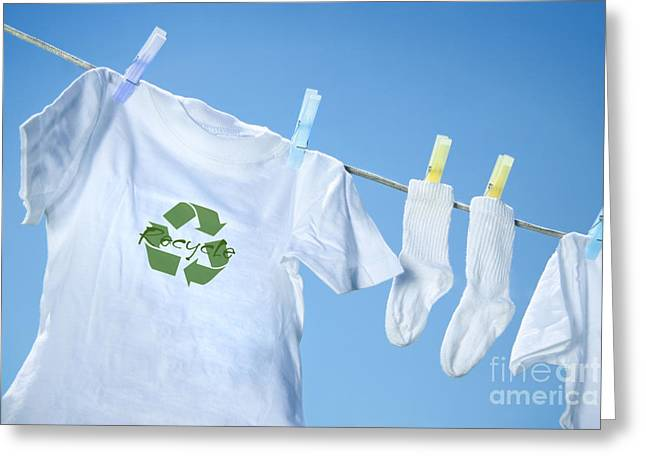 Laundering Greeting Cards - T-shirt with recycle logo drying on clothesline on a  summer day Greeting Card by Sandra Cunningham