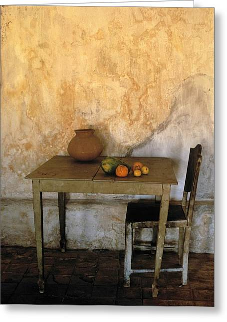Wall Table Greeting Cards - Table And Chairs Infront Of Weathered Greeting Card by Axiom Photographic