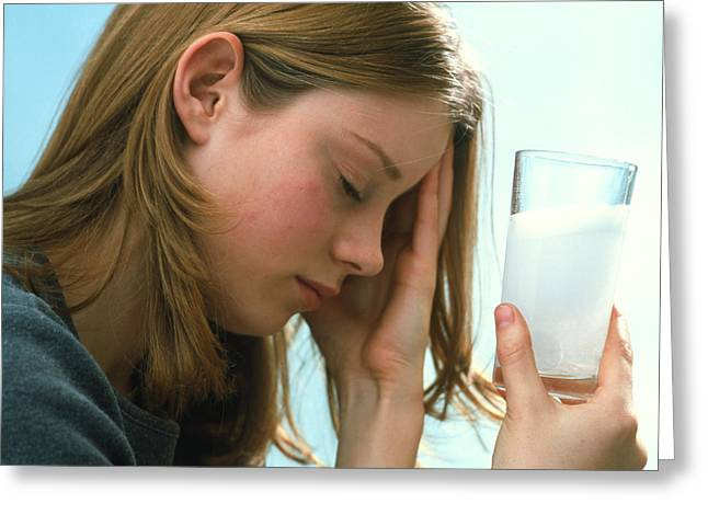 Effervescence Greeting Cards - Teenager With Headache Holds Dissolving Painkiller Greeting Card by Damien Lovegrove