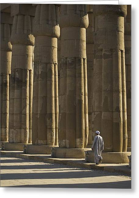 Locals Only Greeting Cards - Temple Guard Walking Past Columns In Greeting Card by Axiom Photographic
