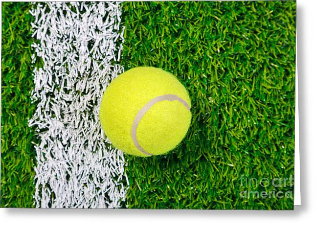 Tennis Ball On Grass From Above. Greeting Card by Richard Thomas