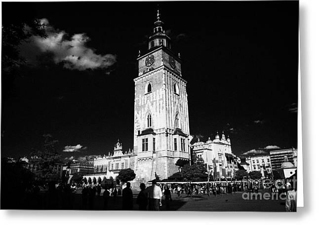 Polish City Greeting Cards - The 13th century  Gothic town hall tower with tourists in rynek glowny town square krakow Greeting Card by Joe Fox