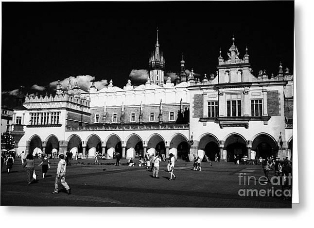 Polish City Greeting Cards - The 16th century Cloth Hall Sukiennice building with tourists Greeting Card by Joe Fox