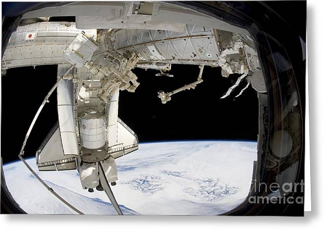 Dexterous Greeting Cards - The Docked Space Shuttle Discovery Greeting Card by Stocktrek Images