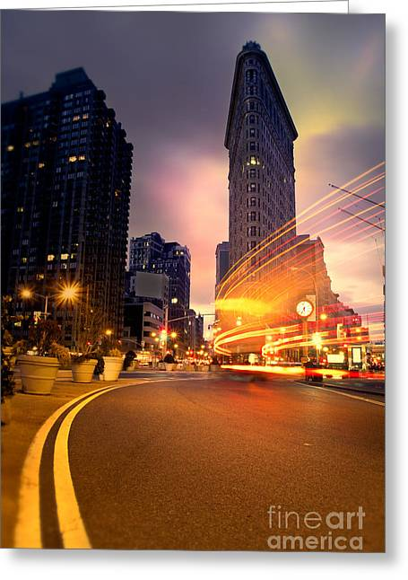 Cold Photographs Greeting Cards - The Flat Iron Building with some magic happening Greeting Card by John Farnan