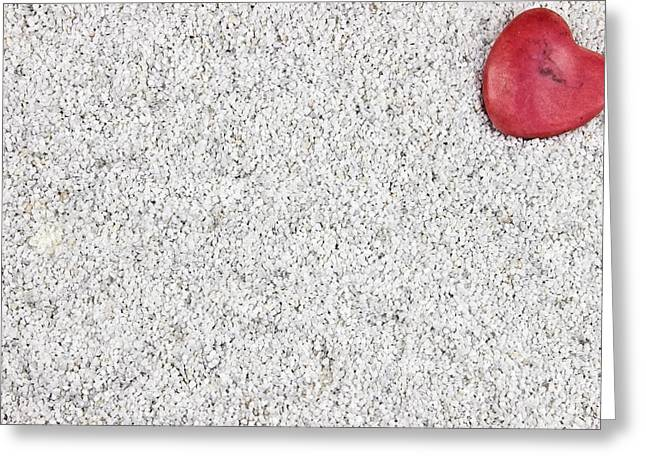 the heart in the sand Greeting Card by Joana Kruse