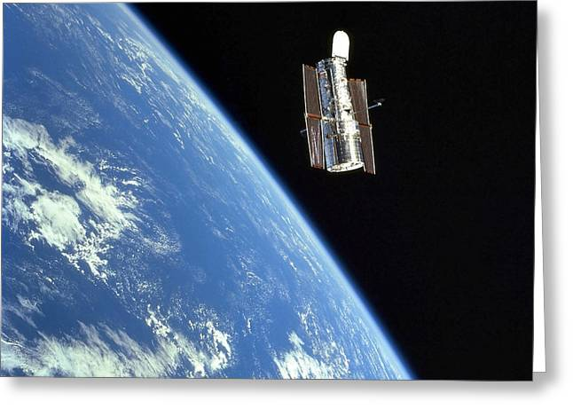 Hubble Space Telescope Views Greeting Cards - The Hubble Space Telescope With A Blue Greeting Card by Stocktrek Images