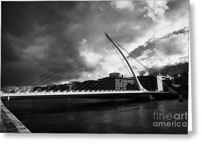 Financial Crisis Greeting Cards - the new Samuel Beckett Bridge across the river liffey in Dublin republic of ireland under dark grey  Greeting Card by Joe Fox