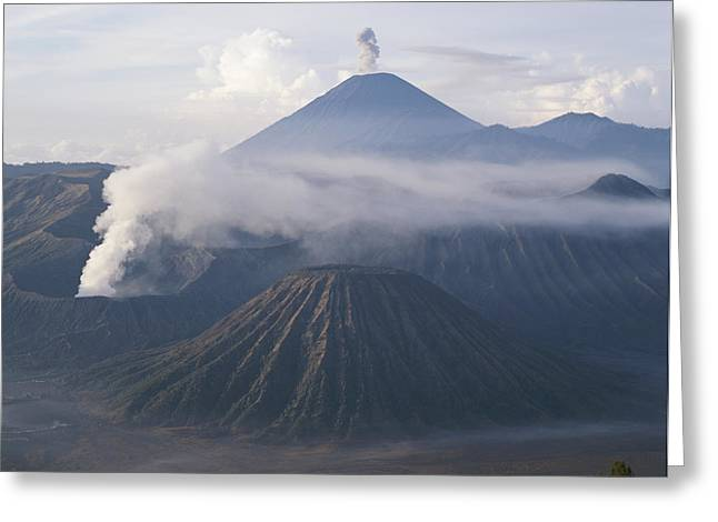 The Peak Of Semaru Rises Above Mount Greeting Card by Carsten Peter