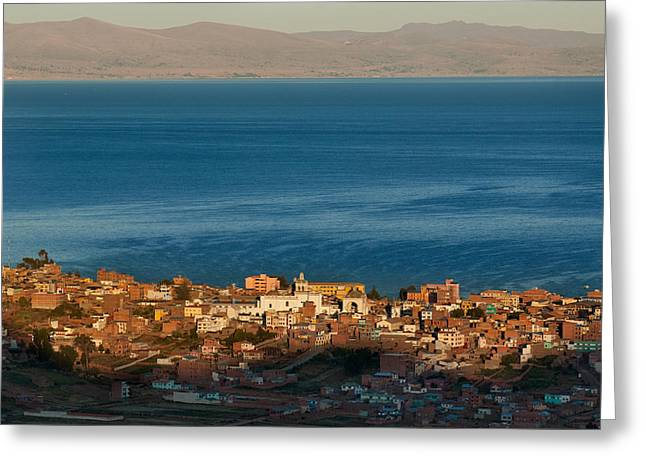 Andes Greeting Cards - The population of Copacabana on the shores of Lake Titicaca. Republic of Bolivia. Greeting Card by Eric Bauer