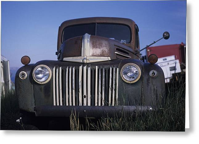 Steamboat Springs Greeting Cards - The Ruins Of A Car Sit In An Open Field Greeting Card by Taylor S. Kennedy