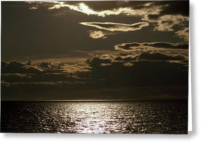 The Setting Sun Pierces A Menacing Greeting Card by Jason Edwards