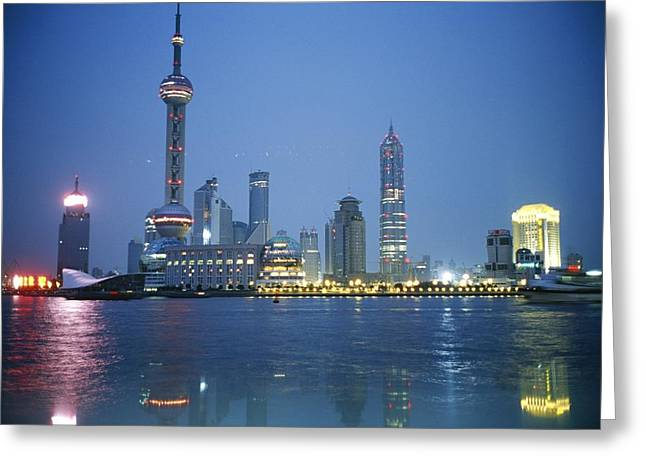 City Lights And Lighting Greeting Cards - The Shanghai Skyline And Riverfront Greeting Card by Raul Touzon