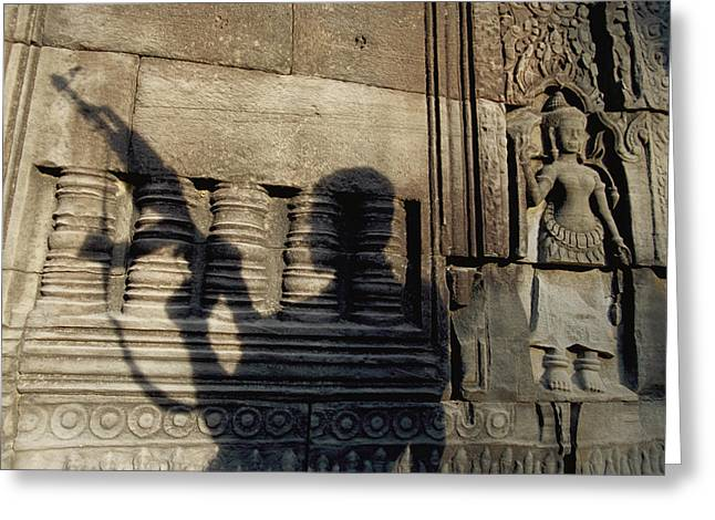 Indochinese Architecture And Art Greeting Cards - The Silhouetted Shadow Of A Man Holding Greeting Card by Paul Chesley
