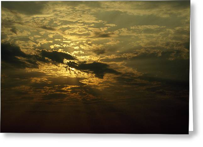 Colorful Cloud Formations Greeting Cards - The Sun Obscured By A Late Afternoon Greeting Card by Jason Edwards