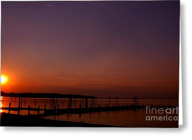 The Sun Sets Over The Water Greeting Card by Clayton Bruster