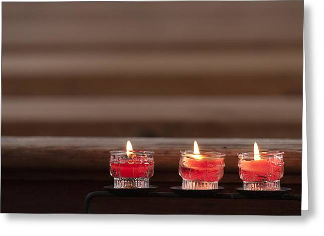 Votive Candles Greeting Cards - Three candles burning in a church Greeting Card by Matthias Hauser