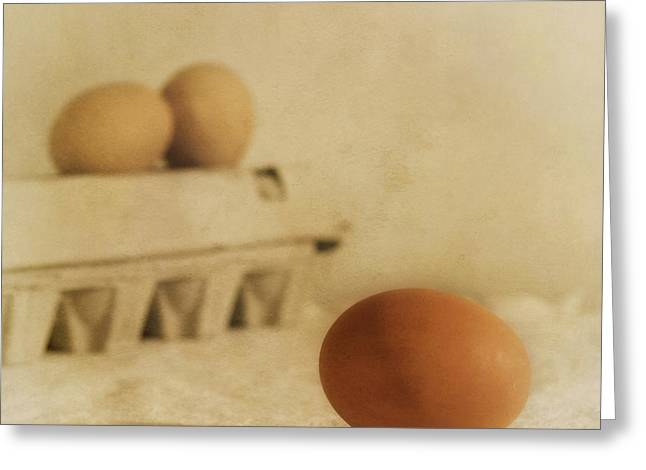 Wettstein Greeting Cards - Three Eggs And A Egg Box Greeting Card by Priska Wettstein