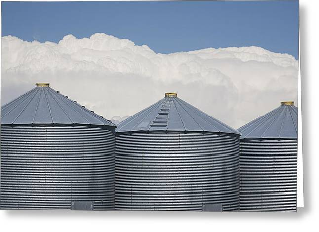 Grain Bin Greeting Cards - Three Grain Bins With Dramatic Thunder Greeting Card by Michael Interisano