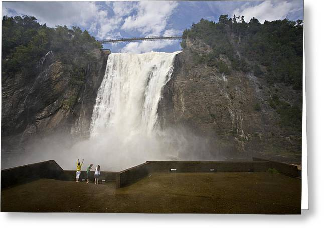 Getting Air Greeting Cards - Three Tourists Get Soaked By Mist Greeting Card by Hannele Lahti