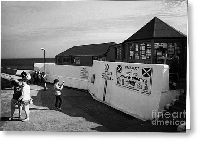 Groat Greeting Cards - tourists at the first and last shop John OGroats scotland uk Greeting Card by Joe Fox