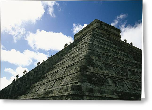 Tourists Climb The Ancient Pyramid Greeting Card by Michael Melford