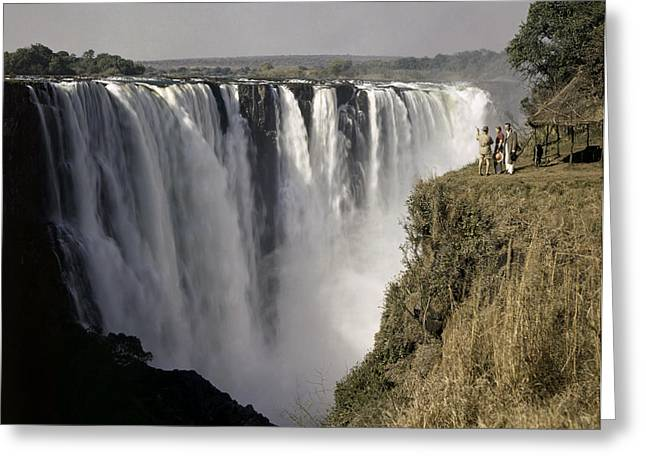 Zimbabwe Greeting Cards - Tourists Look Small Against Backdrop Greeting Card by W. Robert Moore