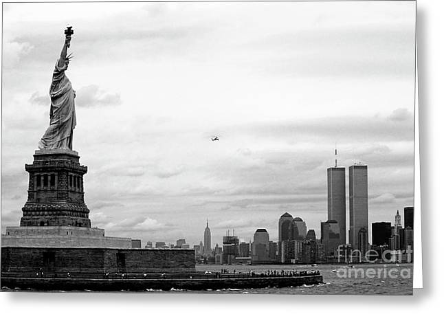 Buildings In The Harbor Photographs Greeting Cards - Tourists visiting the Statue of Liberty Greeting Card by Sami Sarkis