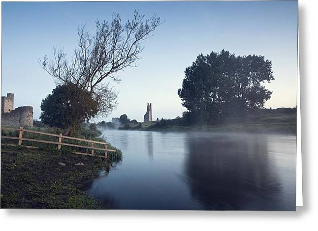Foggy Day Greeting Cards - Trim Castle Along Banks Of The River Greeting Card by Peter McCabe