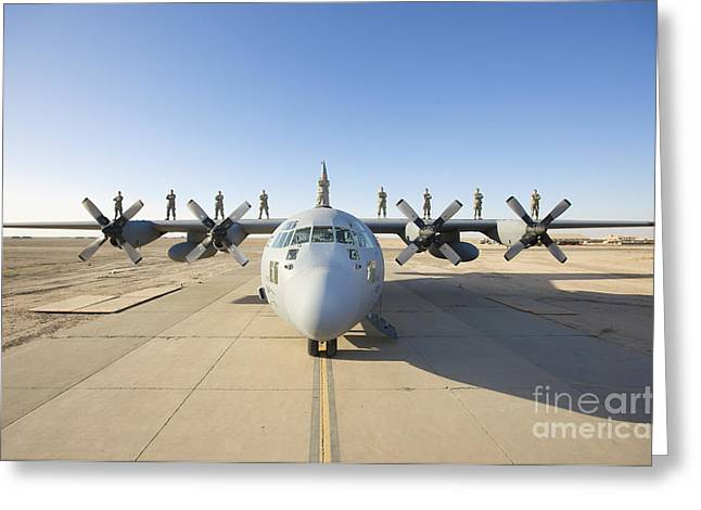 Airbase Greeting Cards - Troops Stand On The Wings Of A C-130 Greeting Card by Terry Moore