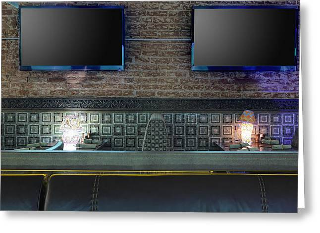 Communication Aids Greeting Cards - Tvs On Brick Wall In Restaurant Greeting Card by Magomed Magomedagaev