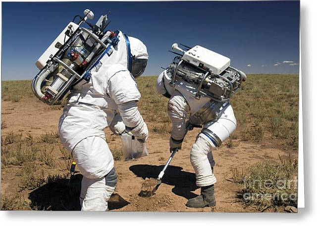 Two Astronauts Collect Soil Samples Greeting Card by Stocktrek Images