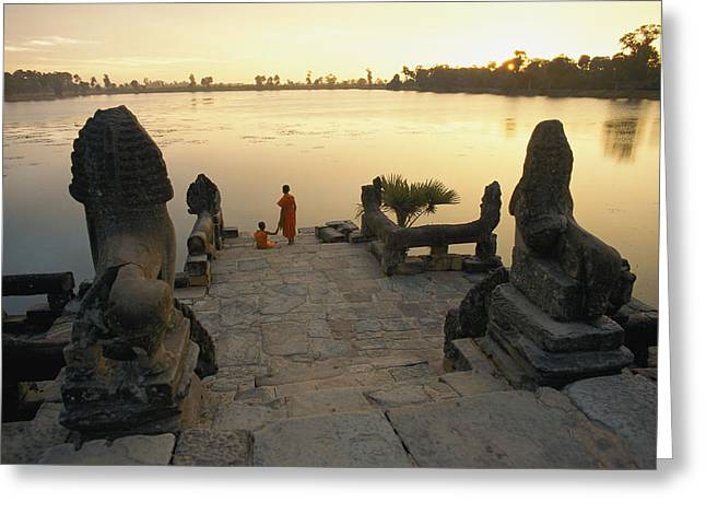 Indochinese Antiquities And Artifacts Greeting Cards - Two Buddhist Monks Sit At The Waters Greeting Card by Paul Chesley