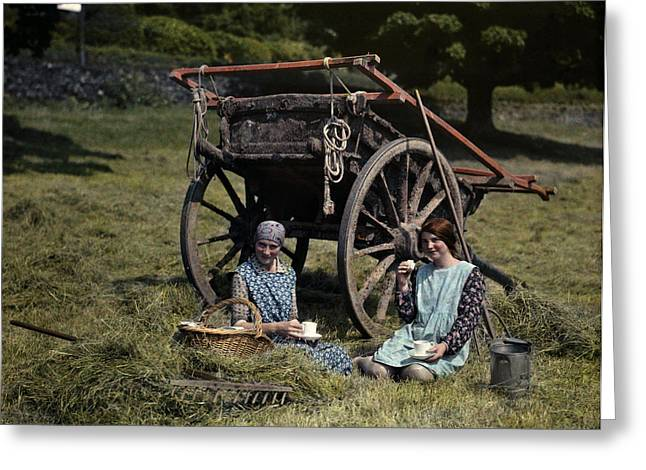 Two Girls Eat Lunch In A Hayfield Greeting Card by Clifton R. Adams