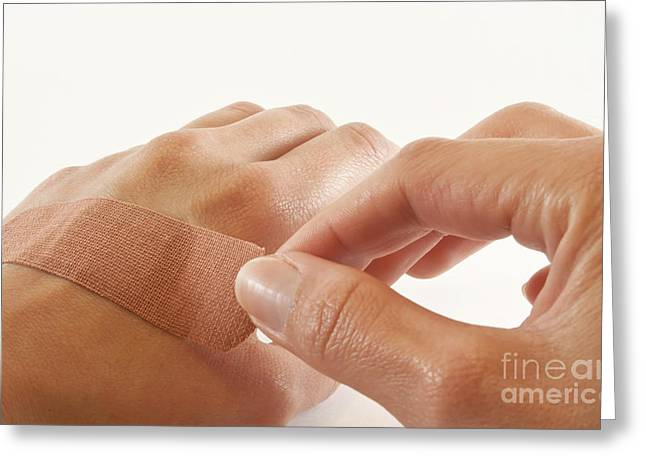 Adhesive Greeting Cards - Two hands with bandage Greeting Card by Blink Images