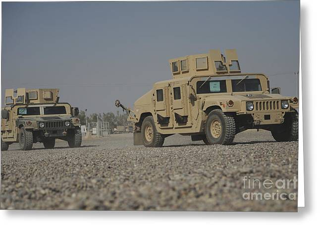 M1114 Greeting Cards - Two M1114 Humvee Vehicles At Camp Taji Greeting Card by Stocktrek Images
