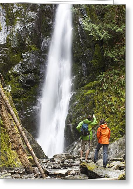 Real People Greeting Cards - Two People Look At A Waterfall Greeting Card by Taylor S. Kennedy