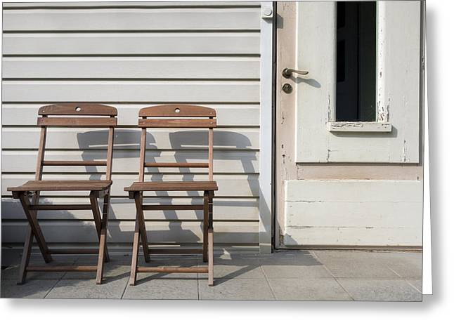 Residential Structure Greeting Cards - Two Wooden Chairs Outside A House Door Greeting Card by Jaak Nilson