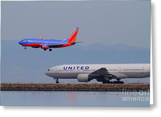 United Airlines Passenger Plane Greeting Cards - United Airlines And Southwest Airlines Jet Airplane At San Francisco International Airport SFO.12087 Greeting Card by Wingsdomain Art and Photography