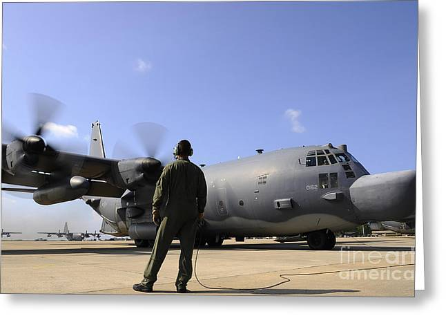 Checking Greeting Cards - U.s. Air Force Airman Observes An Greeting Card by Stocktrek Images