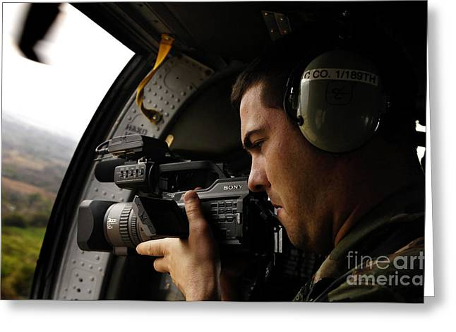 Utility Aircraft Greeting Cards - U.s. Air Force Airman Takes Video Greeting Card by Stocktrek Images
