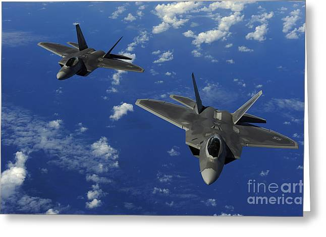 Guam Greeting Cards - U.s. Air Force F-22 Raptors In Flight Greeting Card by Stocktrek Images