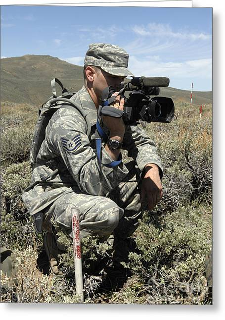 Reporting Greeting Cards - U.s. Air Force Sergeant Shoots Video Greeting Card by Stocktrek Images