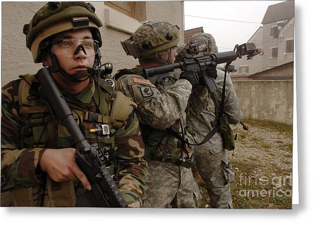Urban Warfare Greeting Cards - U.s. Army Infantry In Pursuit Of A High Greeting Card by Stocktrek Images