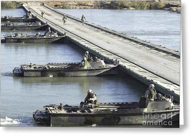 Erection Greeting Cards - U.s. Army Members Position Their Bridge Greeting Card by Stocktrek Images