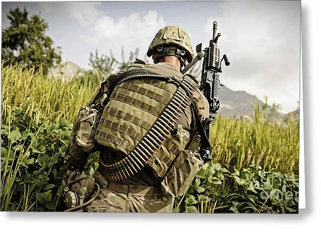 Holding Gun Greeting Cards - U.s. Army Mk48 Machine Gunner Patrols Greeting Card by Stocktrek Images
