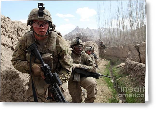 Logar Greeting Cards - U.s. Army Platoon Moves In Behind Mud Greeting Card by Stocktrek Images