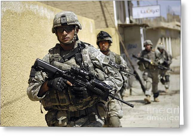 Holding Gun Greeting Cards - U.s. Army Sergeant Leading His Squad Greeting Card by Stocktrek Images